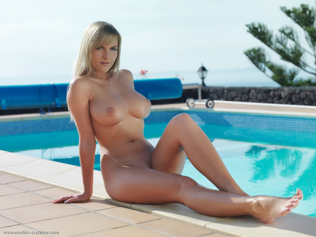 chikita naked poolside lounging