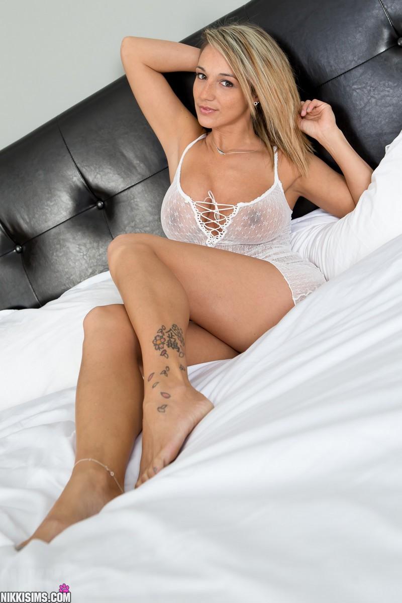 Tattooed ebony nikki with hot lingerie plays