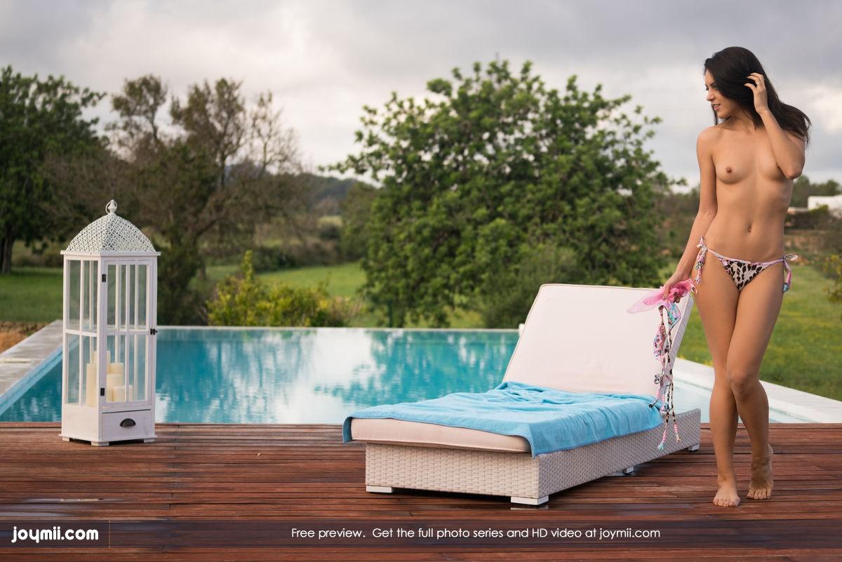 Brunette by pool