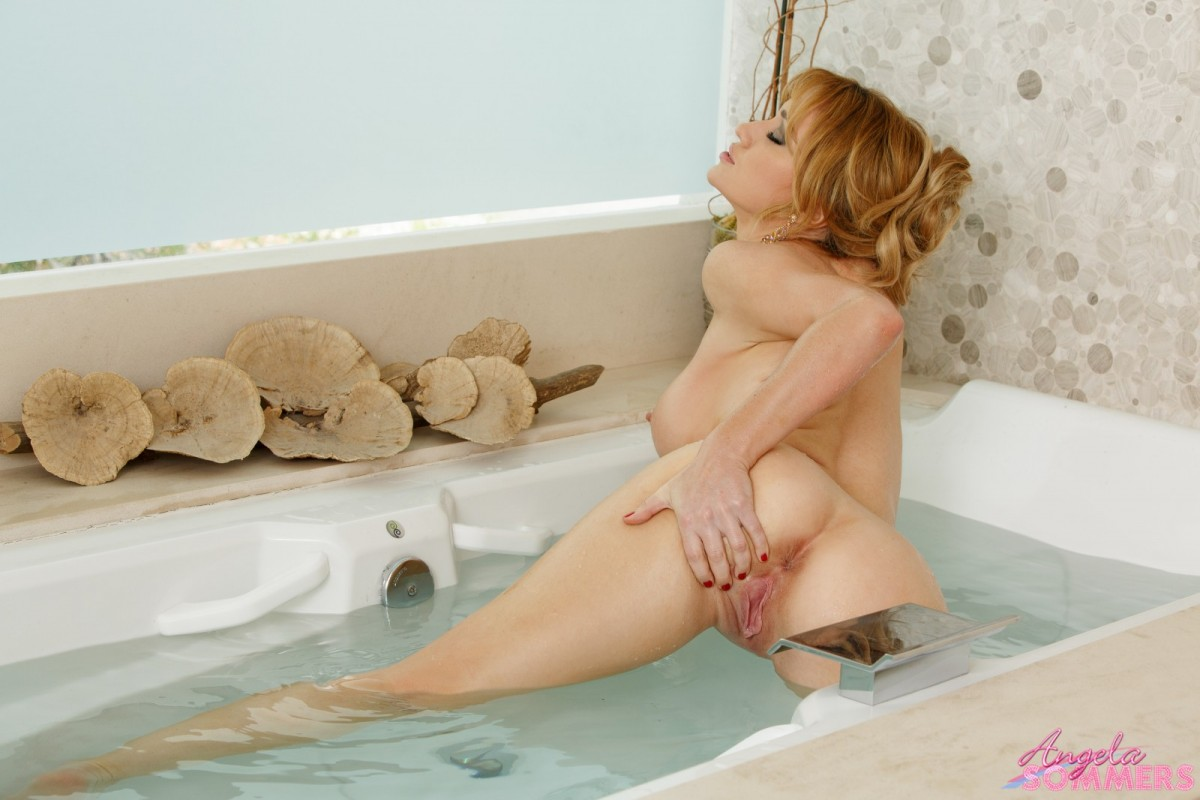 Angela Sommers Spreads in a Bathtub