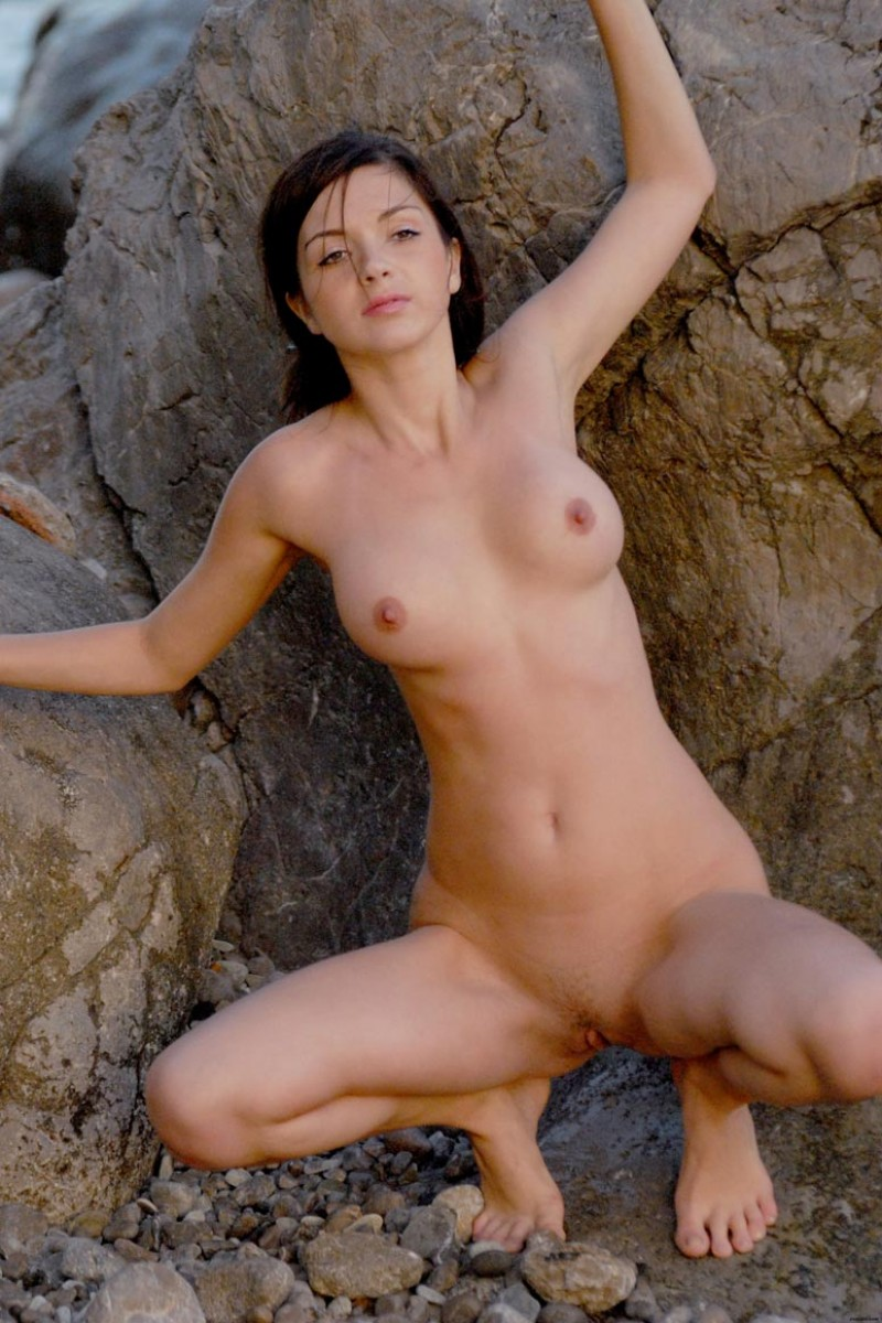 Nude Babe at the Rocky Beach