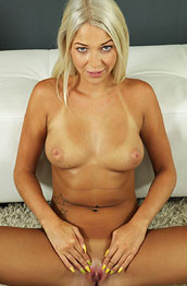 busty-tanlined-blonde-masturbates