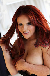 curvy-redhead-shows-tits-in-the-bedroom