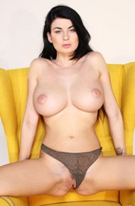 lucy-li-spreads-in-a-yellow-chair