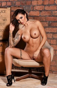 gemma-massey-strips-in-a-lounge-chair