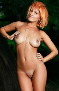 viola-a-tanlined-redhead-in-the-woods