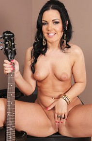 nina-black-naked-with-a-guitar