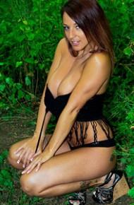 Nikki Sims Posing in the Woods