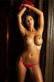 Topless Busty Brunette in a Red Thong
