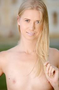 Slim Violette Posing Naked on Grass