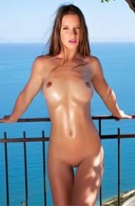 Oiled Nude Model on the Balcony