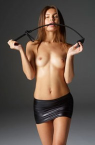 Topless Girl in a Sexy Leather Miniskirt