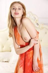 Adrijana Takes off her Orange Dress
