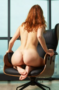 Clarice Spreads in a Lounge Chair