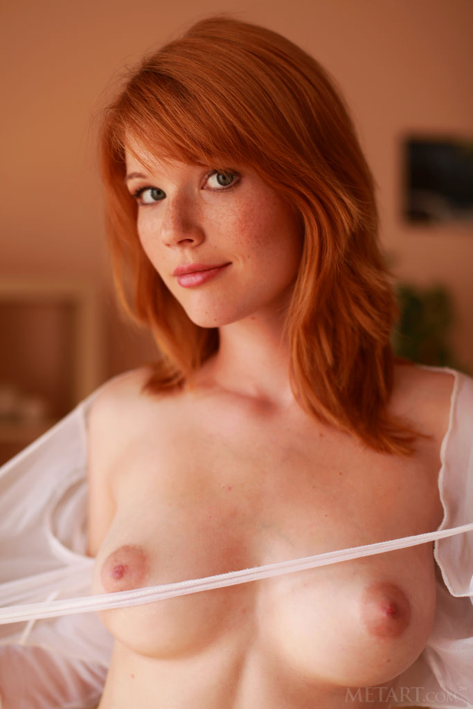 Cute redhead shows off her prime assets 9