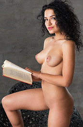 Yulianna Posing Naked with a Book