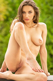 Gloria Sol Naked on a Wooden Bench