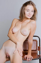 Madeline Y Spreads Naked in a Chair